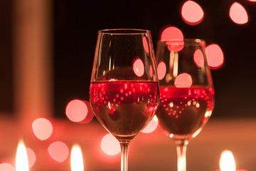 Wine and romance.  Romantic candle light dinner.