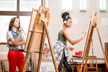 Young creative multi ethnicity students drawing at the university studio