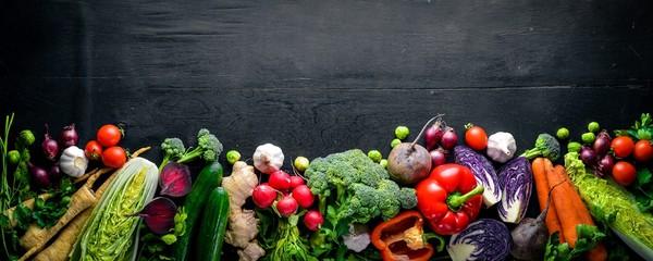 Wall Mural - Big set organic food. Fresh raw vegetables. On a black chalkboard.