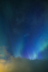 Aurora Borealis Known as Nother Lights Playing with Vivid Colors Over Lofoten Islands in Norway.