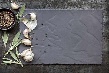 Food Background Garlic Sage and peppercorns on Slate Top View