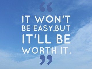 "Inspirational quote ""it' won't be easy, but it will be worth it"" on blue sky background"