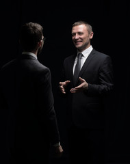 Close up photo two businessmen in suits discussing isolated in b