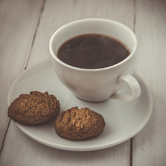 Cup of hot espresso and cookies