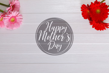 Gerbera flowers on white wood vintage background. Happy Mothers day design. Fresh natural flowers. Painted wooden planks.
