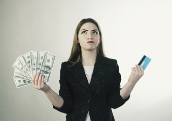young woman with cash an card in her hands holding