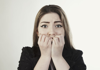 Close up portrait of scared young woman photo