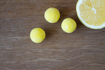 Close view of lemon candy and lemon