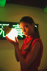 Vertical image of Woman holding Burning light bulb