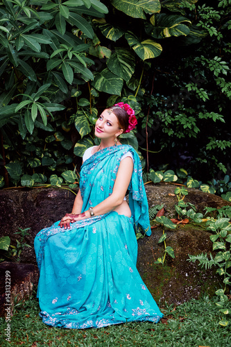 Beautiful young indian woman in traditional clothing with