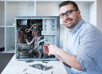 Professional man repairing and assembling a computer