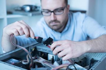 Professional man repairing and assembling a computer