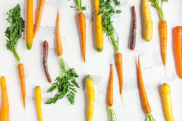 Carrots. Fresh colorful carrots on white background. Flat lay, top view