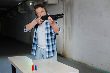 Nice handsome man holding a gun