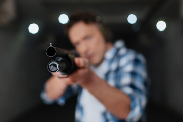 Selective focus of a gun muzzle