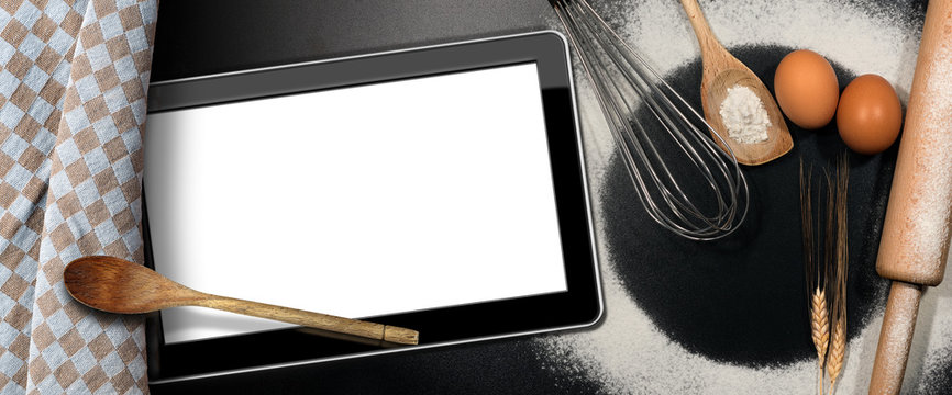 Tablet Computer on a Baking Background