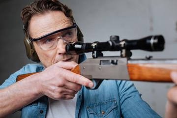 Skilled professional marksman having target practice
