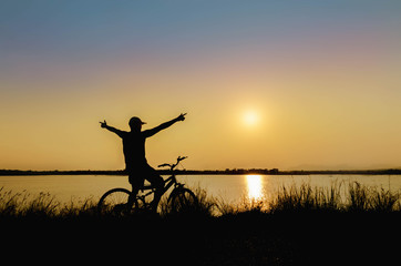 silhouette of cyclist in nature background and beautiful sunset
