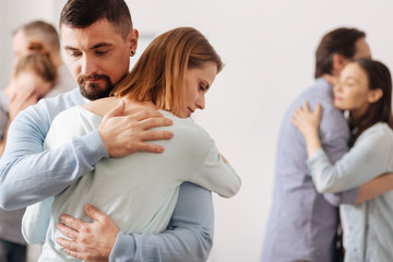 Brave male person embracing his coworker