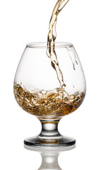 Wall Mural - Brandy or whiskey is poured into a glass