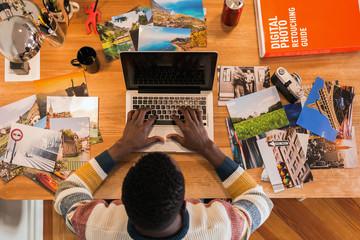 Photographer editing photos in the laptop