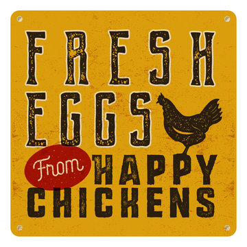 Farm fresh eggs poster on yellow vintage rusty metal background with chicken. Retro typography style