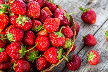 Fresh strawberries in the basket, fruits on farmer market table