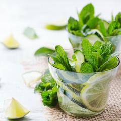 Cucumber lime mint fresh infused water detox drink cocktail lemonade