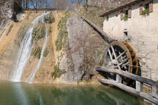 Ancient but active watermill wheel