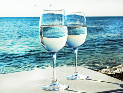Two glasses of wine on beach