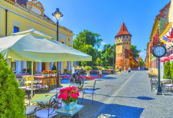 Little square and The Carpenters' Tower in Sibiu city, Transylvania region, Romania. Wall mural