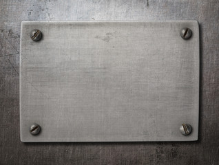 Wall Mural - old steel plate with bolts on metal background