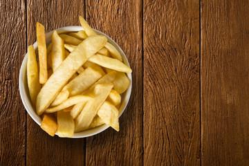 Potato fried portion on the wood background