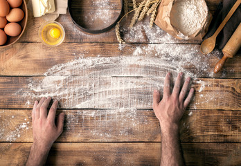 Wall Mural - male hands prepares a place for cooking dough