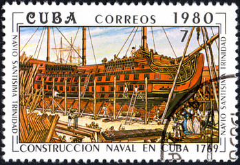 UKRAINE - CIRCA 2017: A postage stamp printed in Cuba shows shipbuilding on shipyard from series Constructing of ships on Cuba, circa 1980