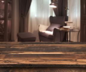 Senior citizen blur living room interior, wooden table in front