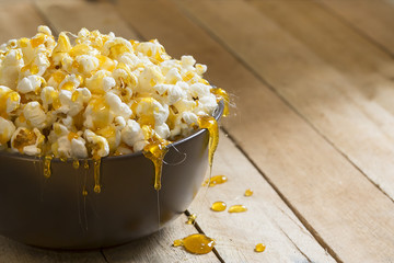Popcorn in a bowl with dripping caramel on top