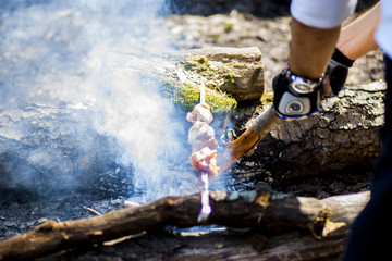 Meat is fried on fire in the forest