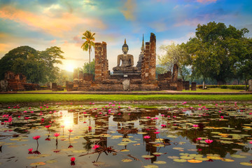 Poster Temple Wat Mahathat Temple in the precinct of Sukhothai Historical Park, a UNESCO world heritage site in Thailand