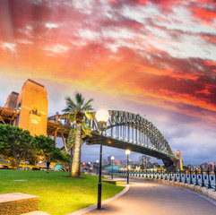 Beautiful view of Sydney Harbour Bridge with sunset sky, Australia