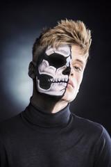 Bodypainting half skeleton half human portrait