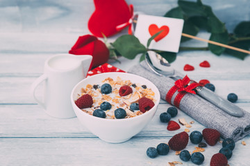 Granola with milk and berries. Healthy breakfast. Musli in bowl