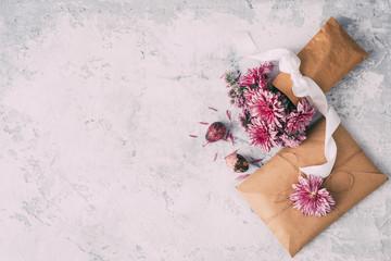 Spring purple flowers in paper bag