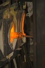Glass furnace. Glass Blower at Work