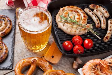 Beer mug, grilled shrimps, sausages and pretzel