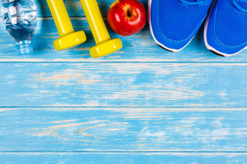 View of concept of fitness and dieting plan on blue wood background.