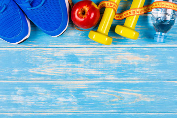Dieting concept plan on blue wood background.