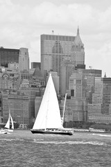 Boat with white sails on Hudson river