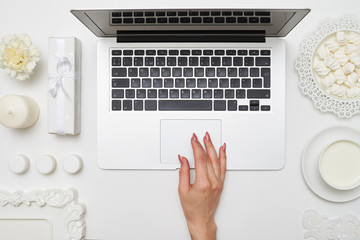 Overhead shot of a female hand using touchpad
