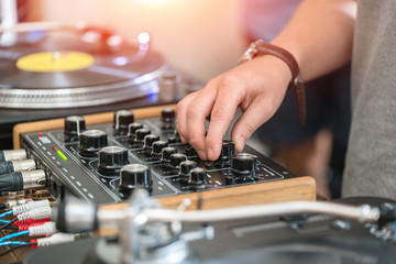 Dj play music at hip hop party.Turntable vinyl record player,analog sound technology for disc jockey to scratch vinyl records and mix tracks